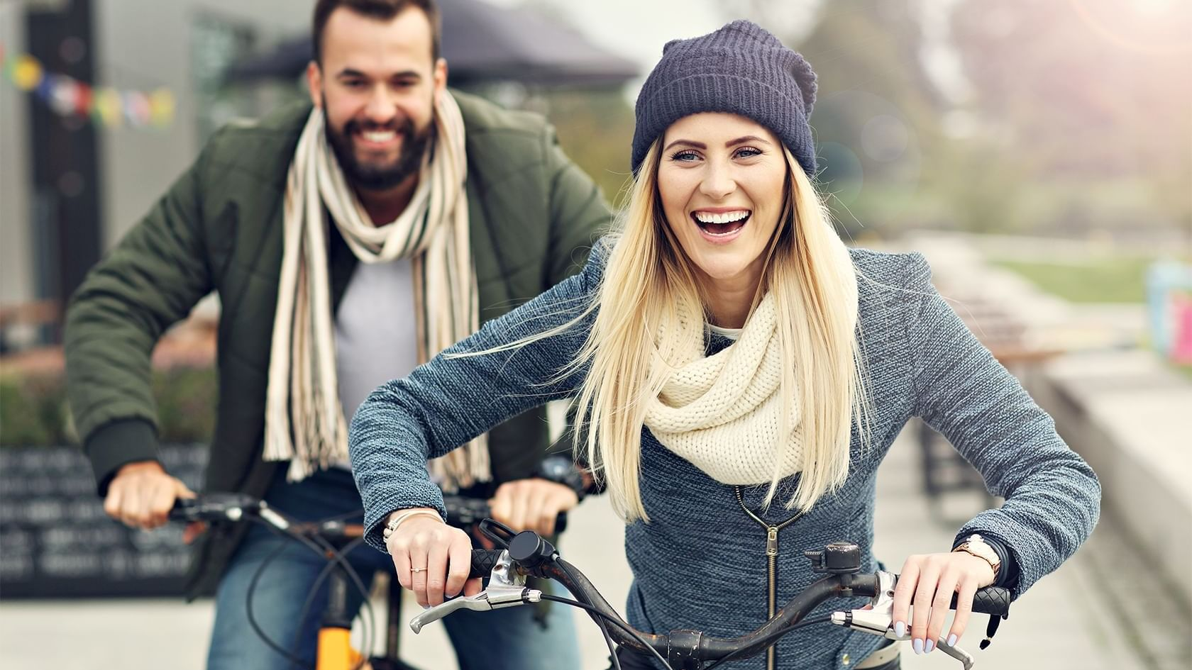 a man and woman riding bikes