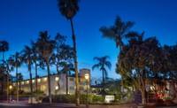 The West Beach Inn, a Coast Hotel - Night Exterior