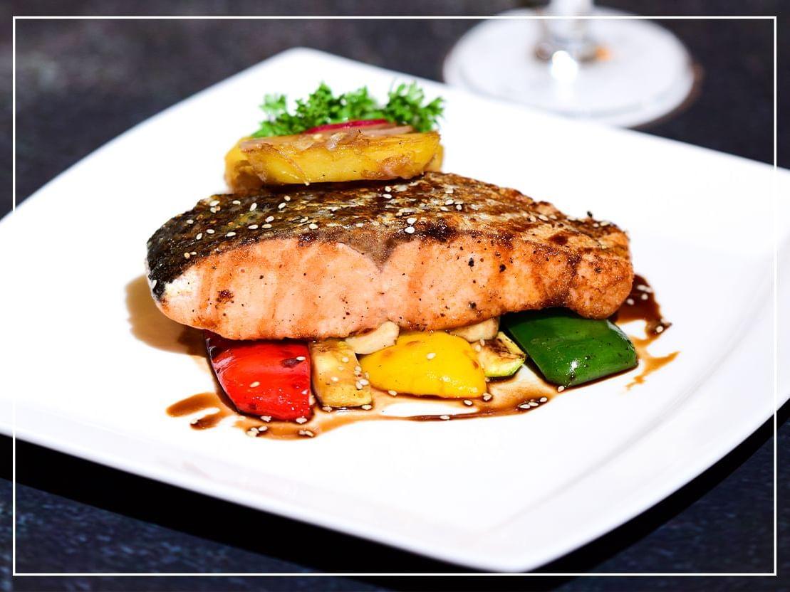 Sea food dish at River Barge Restaurant at Chatrium Hotel