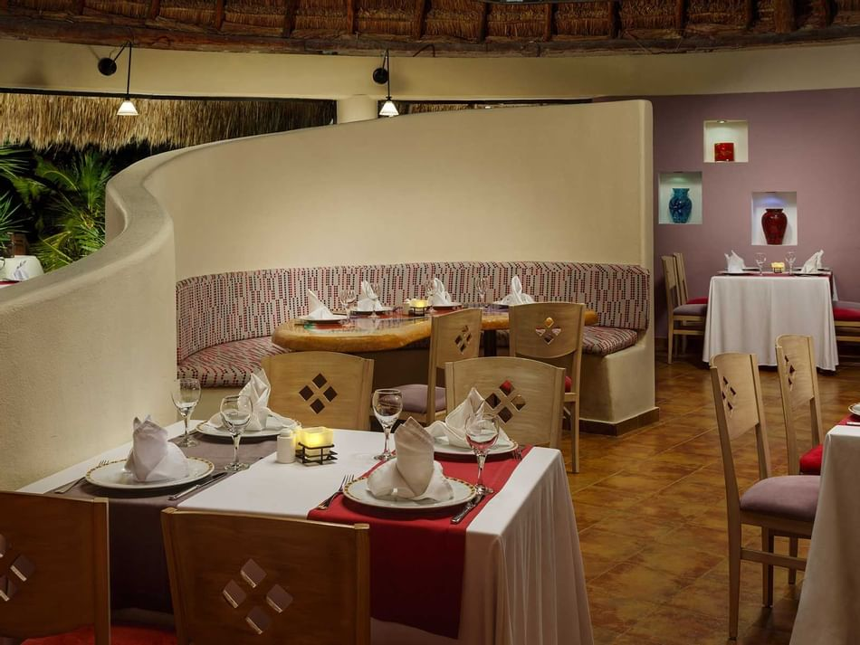 Dining tables in Sabor Latino Restaurant at The Reef Coco Beach