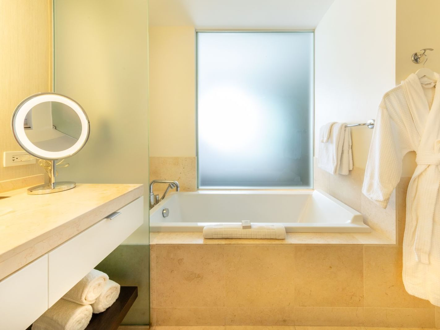 a tub in a hotel bathroom