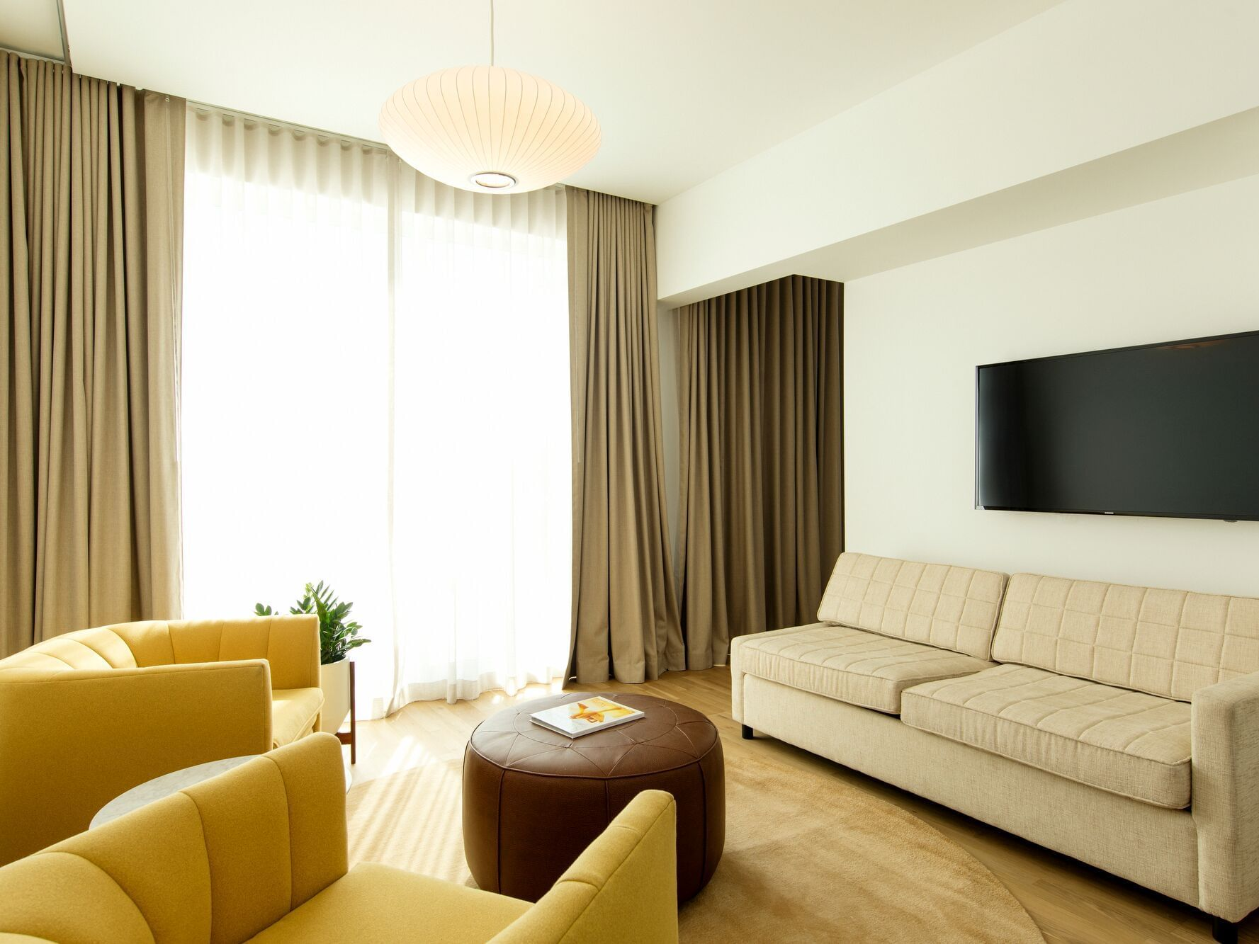 living room area with sofa and chairs