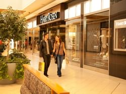 A couple shopping at the CF Chinook Centre near Carriage House Hotel
