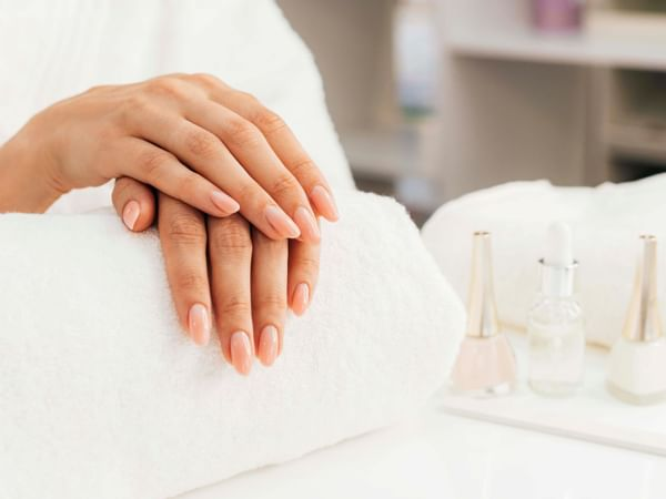 A woman receiving a manicure at the Spa in Manteo Resort