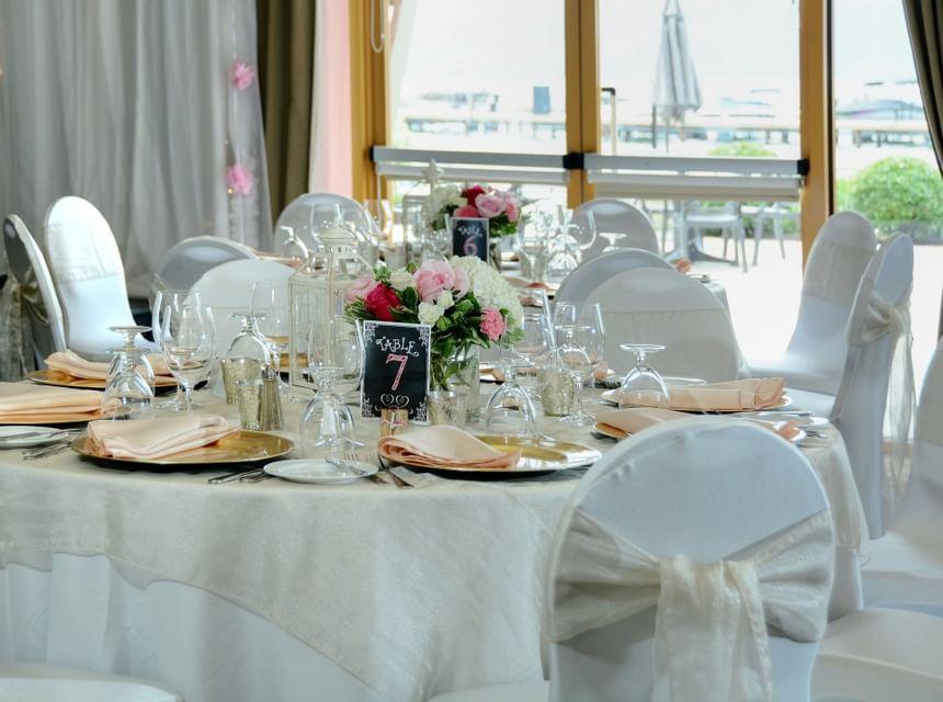 Event hall with wedding reception arrangements at Manteo Resort