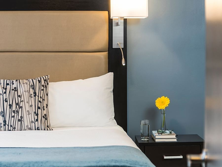room with bed and nightstand