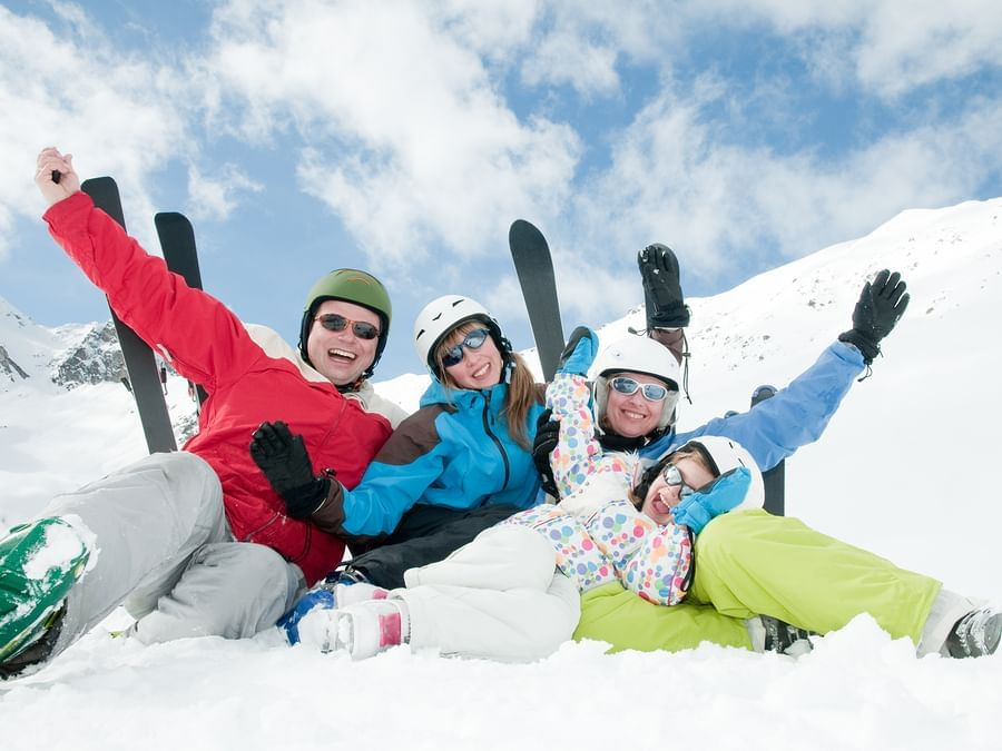 group of skiiers happy in the snow