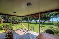 patio view at Waimea Plantation Cottages with rockers and a table