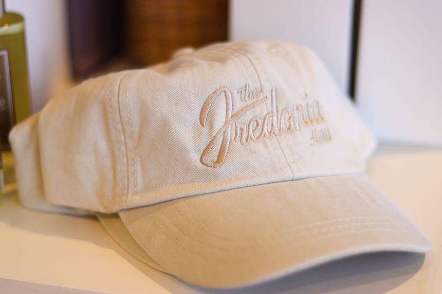 a white fredonia hotel baseball cap