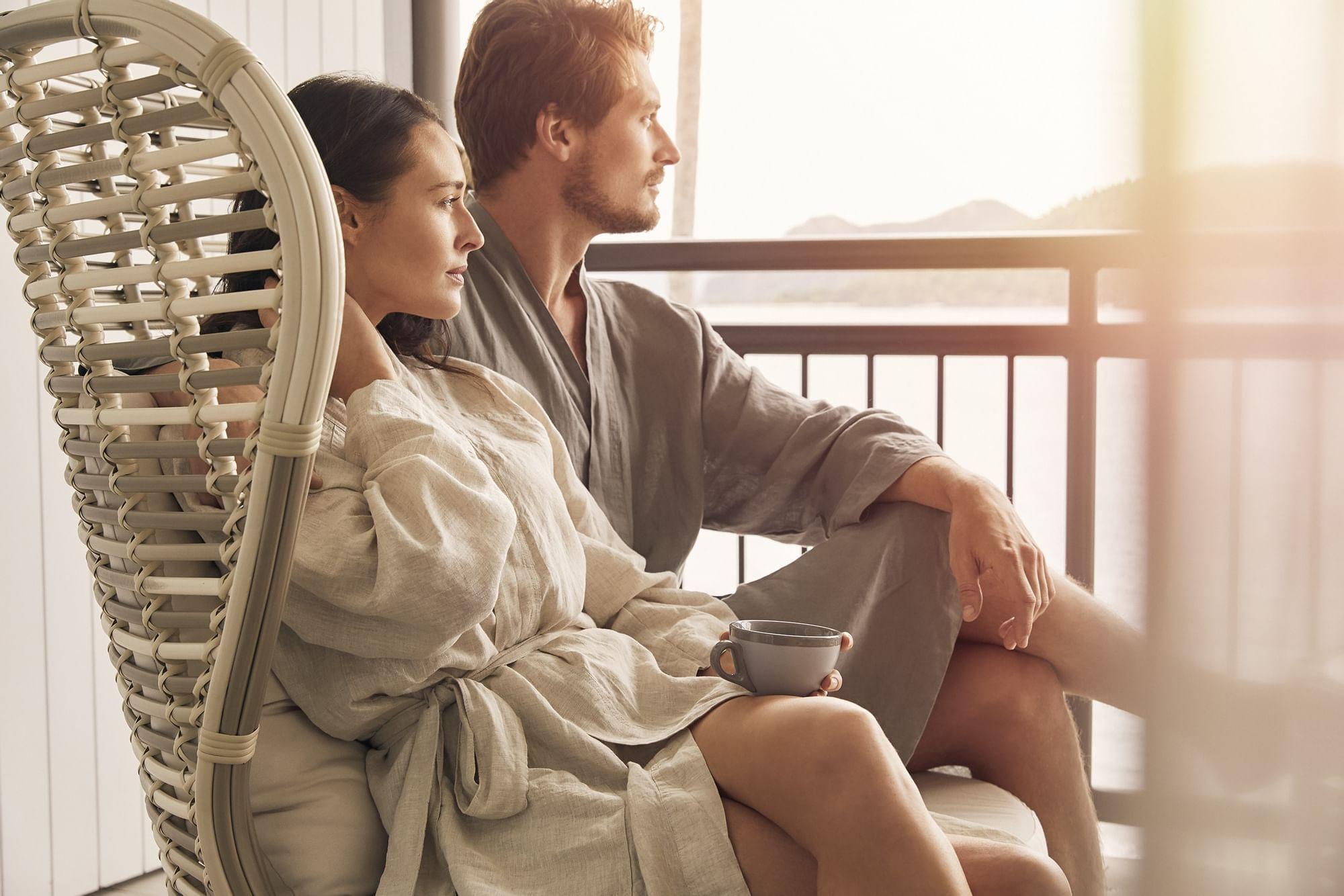 Couple watching sunset from Daydream Island Resort