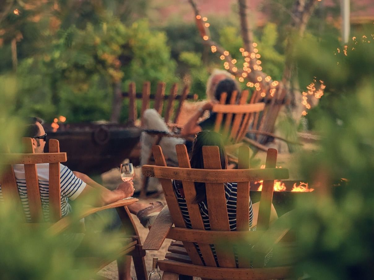 Guests sitting on lawn chairs in garden