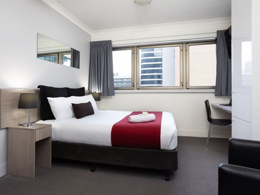Comfy double bed in Queen room at George Williams Hotel