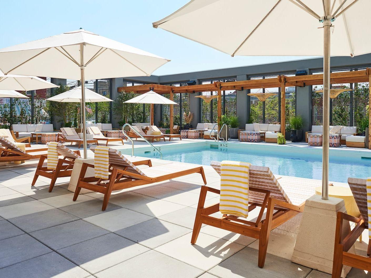 Sunbeds near Poolside Lounge at the Rockaway Hotel