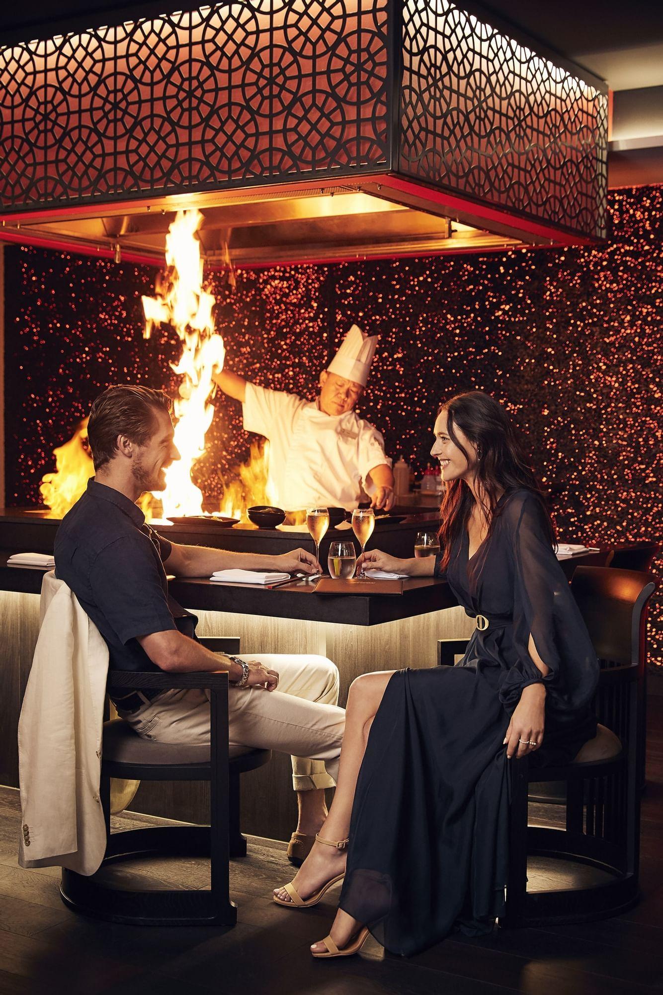Couple sitting at grill bar at Daydream Island Resort