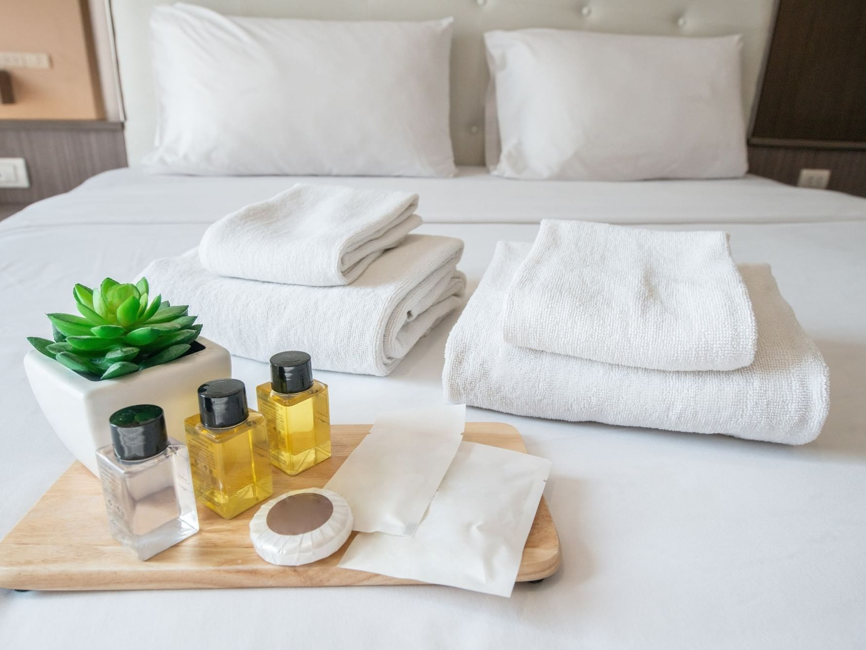 Toiletries and towels on bed at Daydream Island Resort