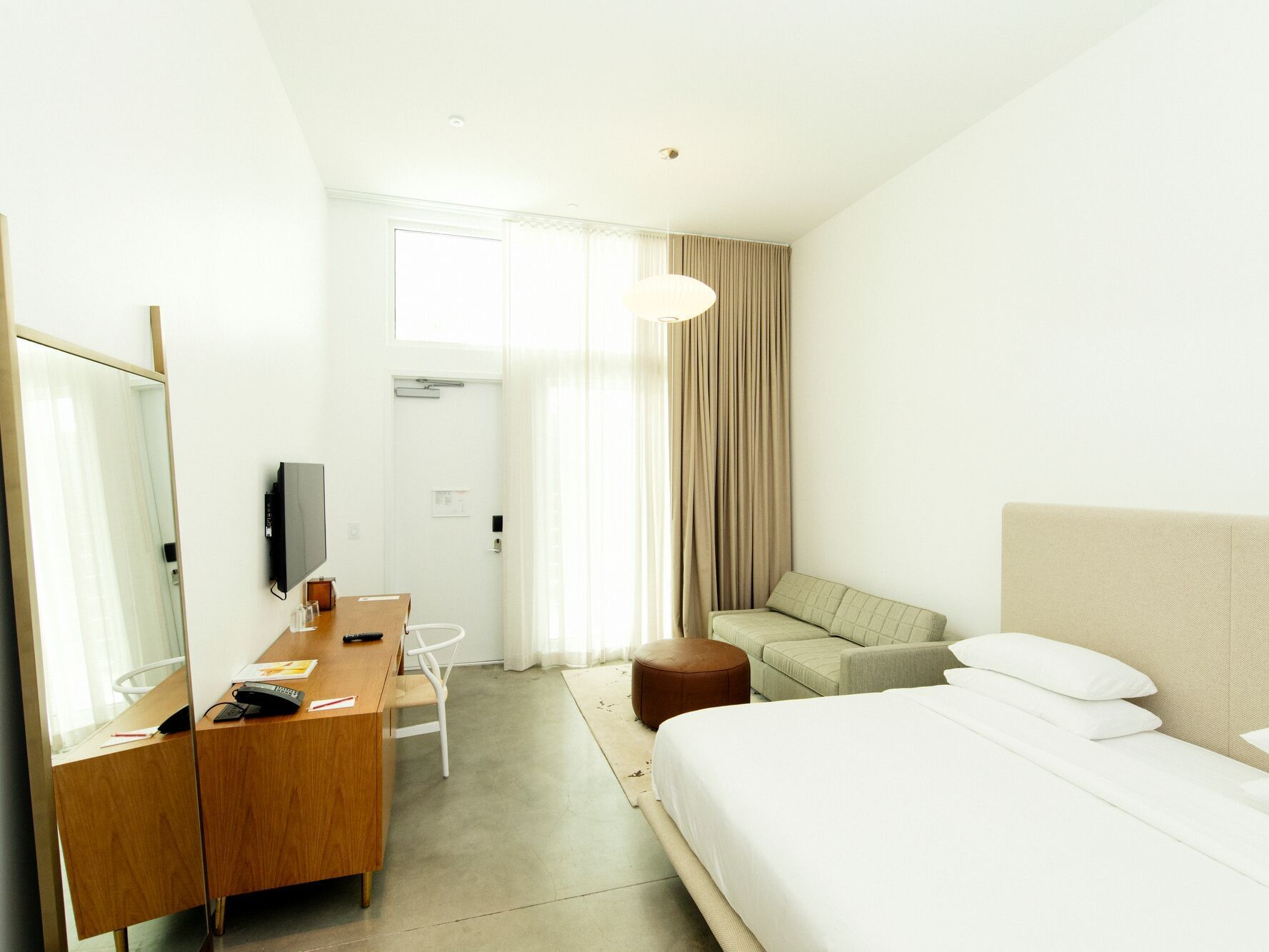 room with king bed, sofa and workstation