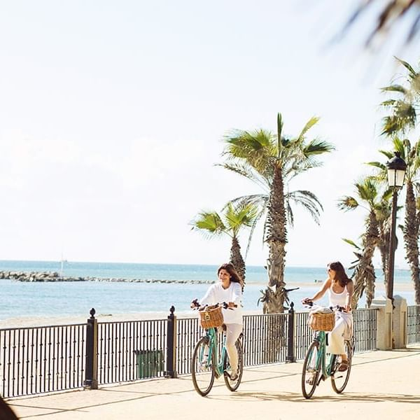 Two Ladies riding bicycles