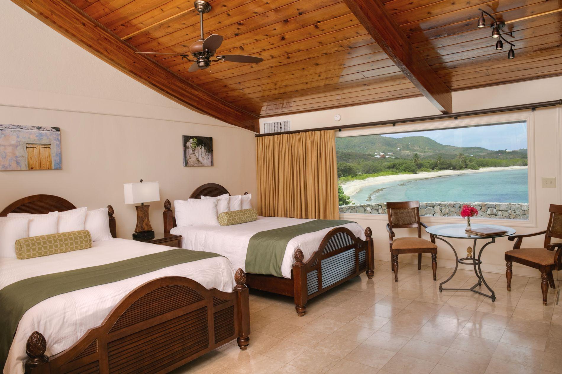 Deluxe Oceanfront Suite Bedroom with Ocean View