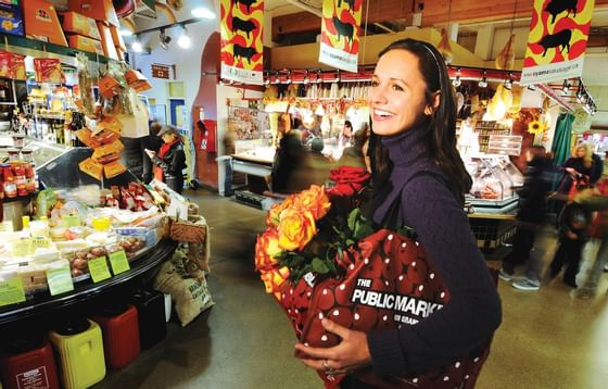 woman shopping at Granville market near Granville Island Hotel