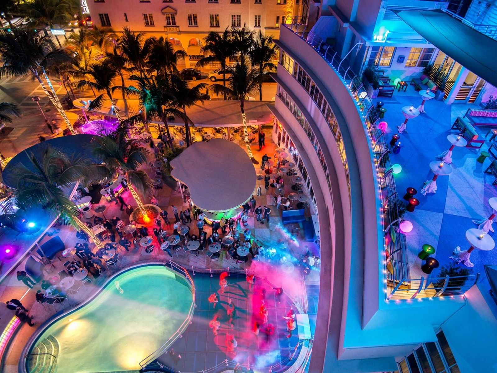 A view of night pool party in  POOL+PATIO at Essex House by Clevelander