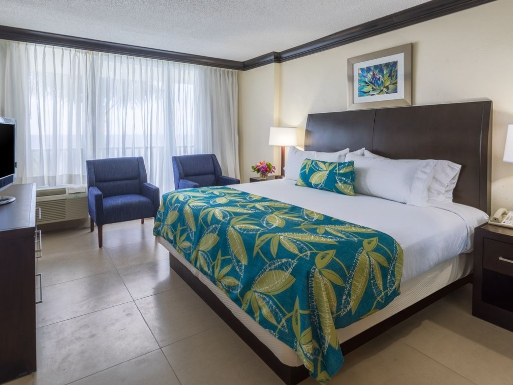 Bed & furniture in Rosehall room at Holiday Inn Montego Bay