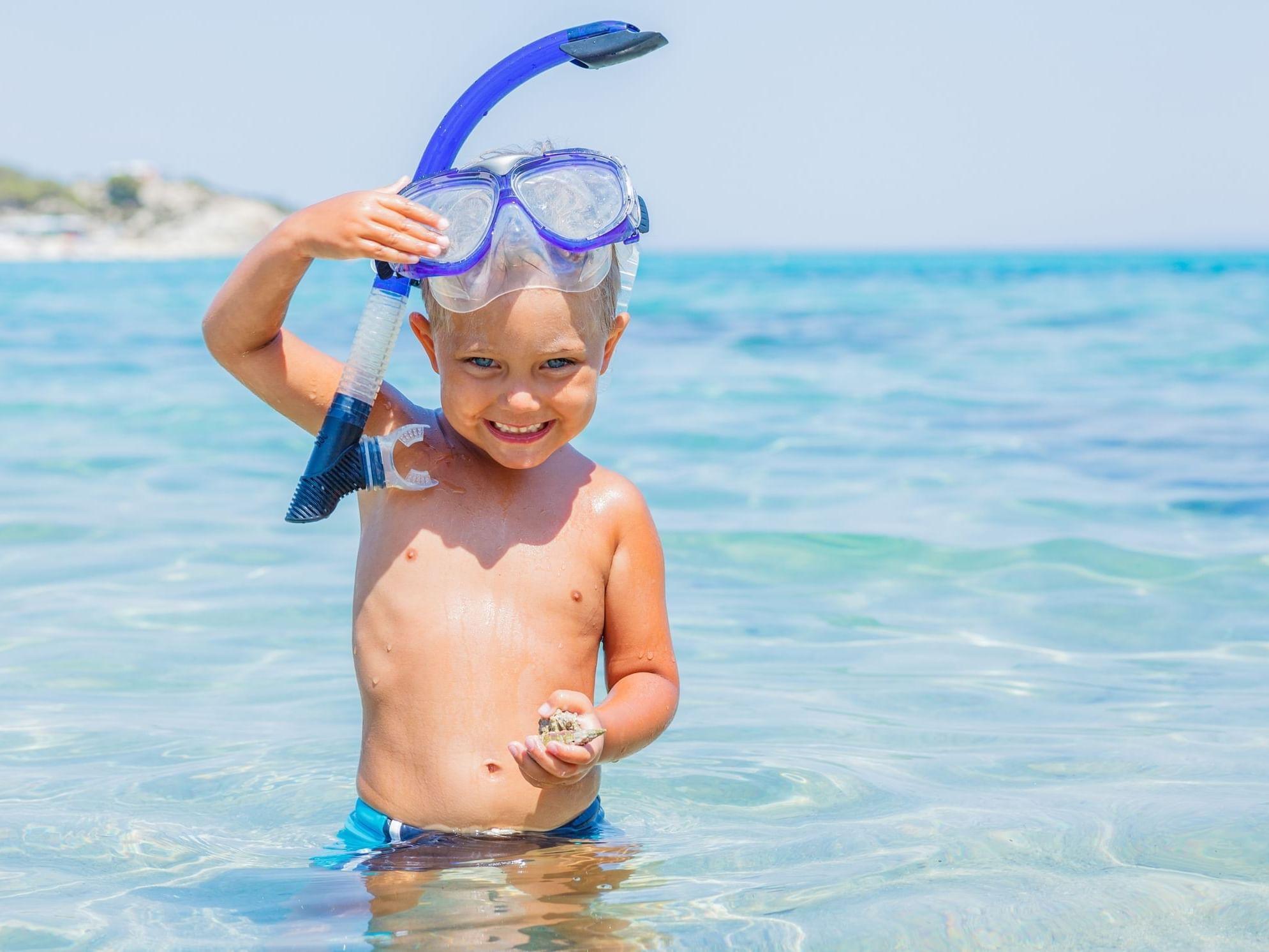 Kid snorkeling in sea near Daydream Island Resort