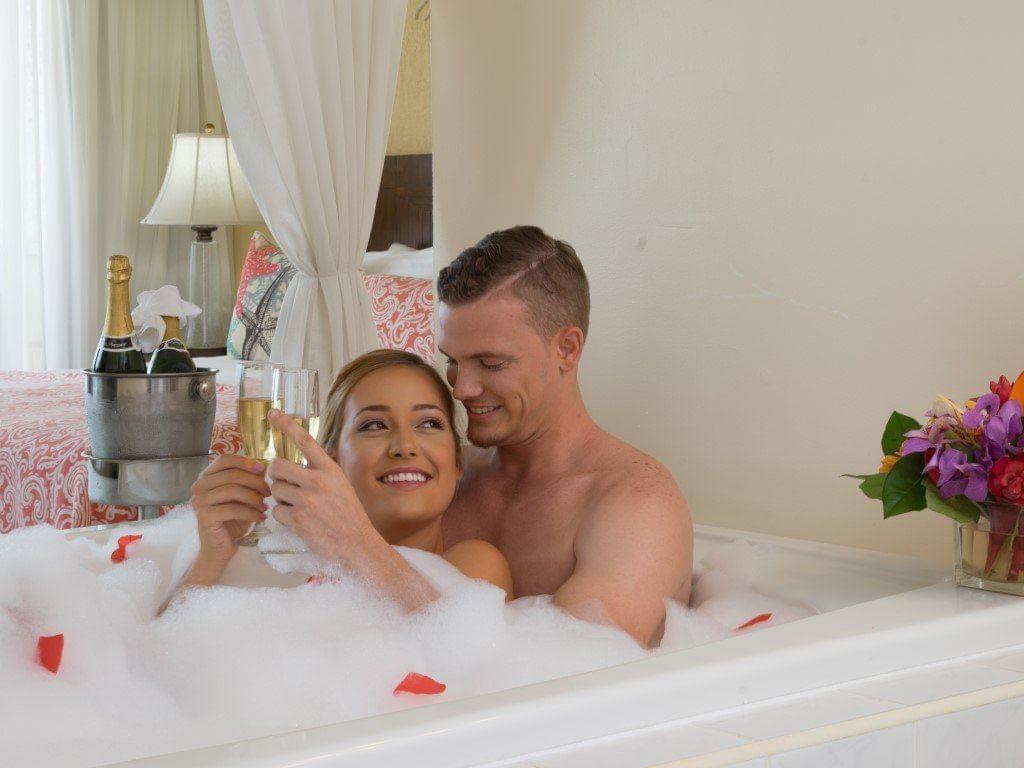 A couple enjoying in a bathtub at Holiday Inn Montego Bay