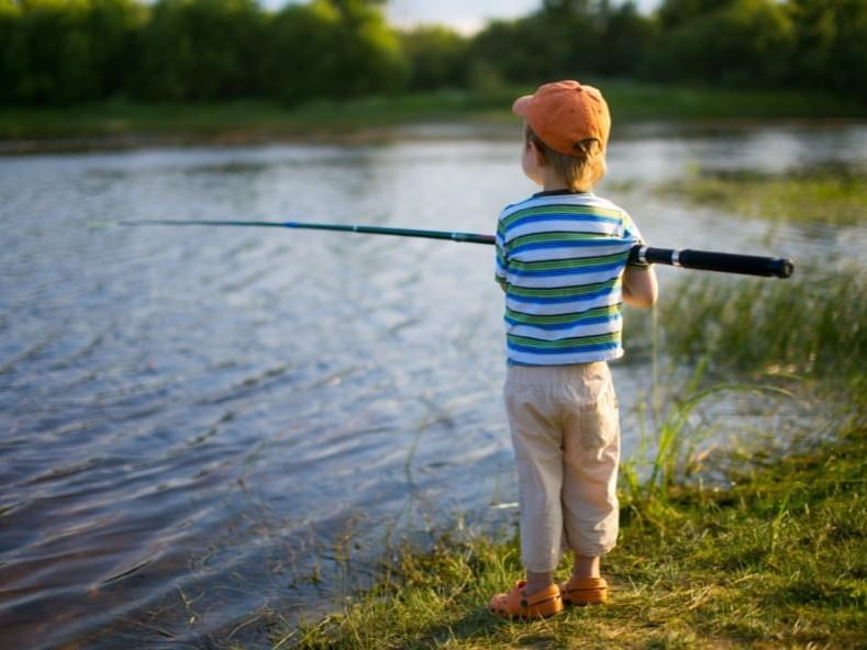 kid in hat fishing
