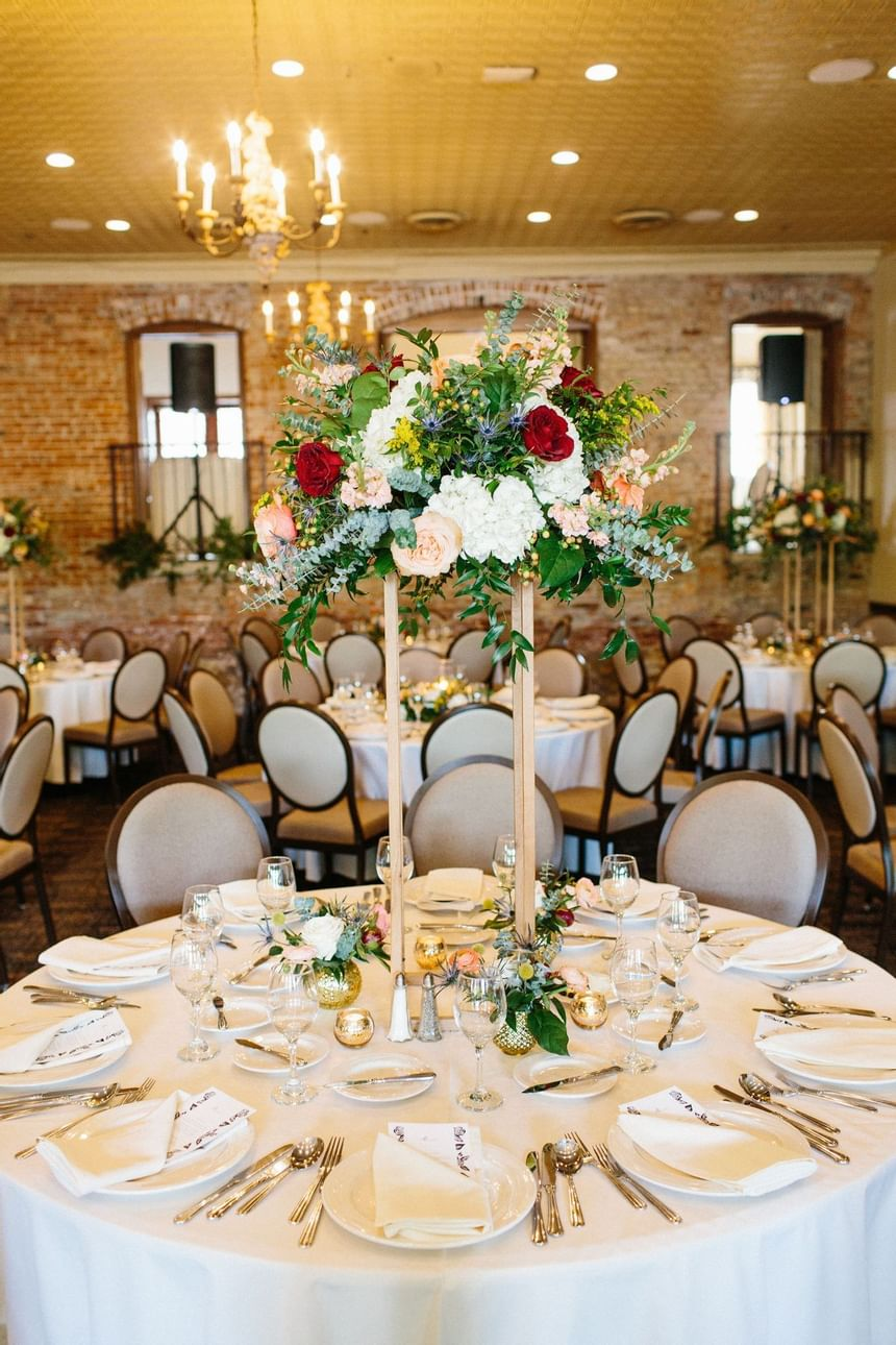decorated tables and chairs in ballroom