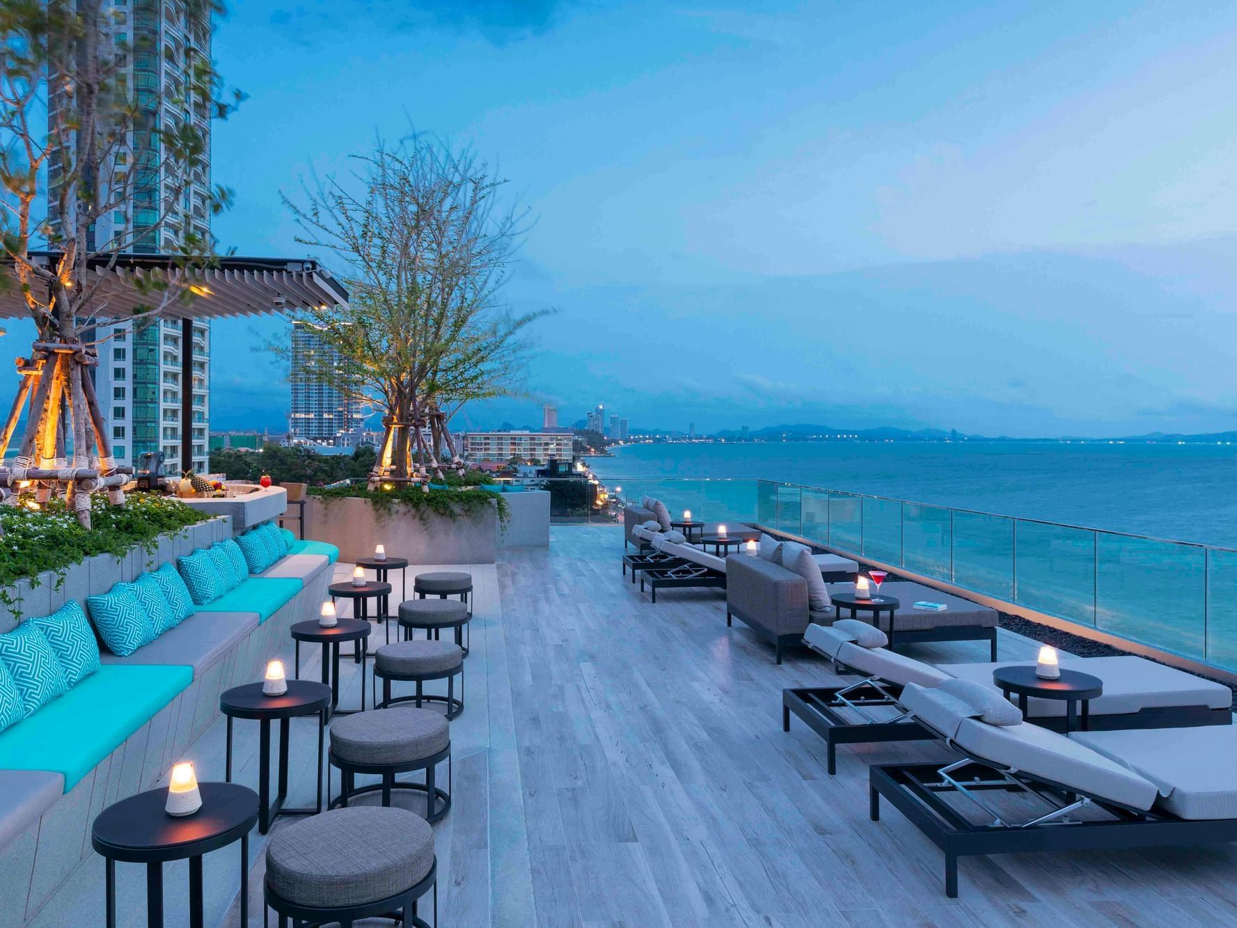 outdoor pool lounge area facing the sea at U Hotels and Resorts