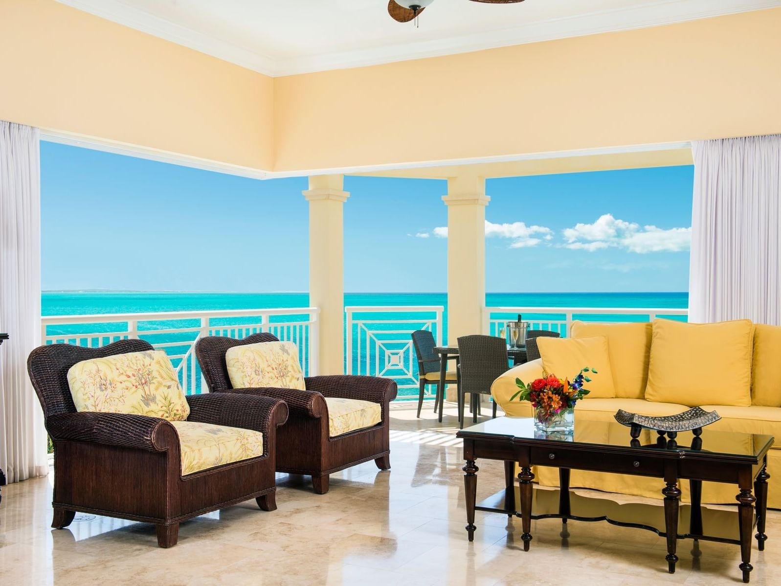 Living room of 2 Bedroom Oceanfront Penthouse with Roof Terrace at Windsong Resort On The Reef
