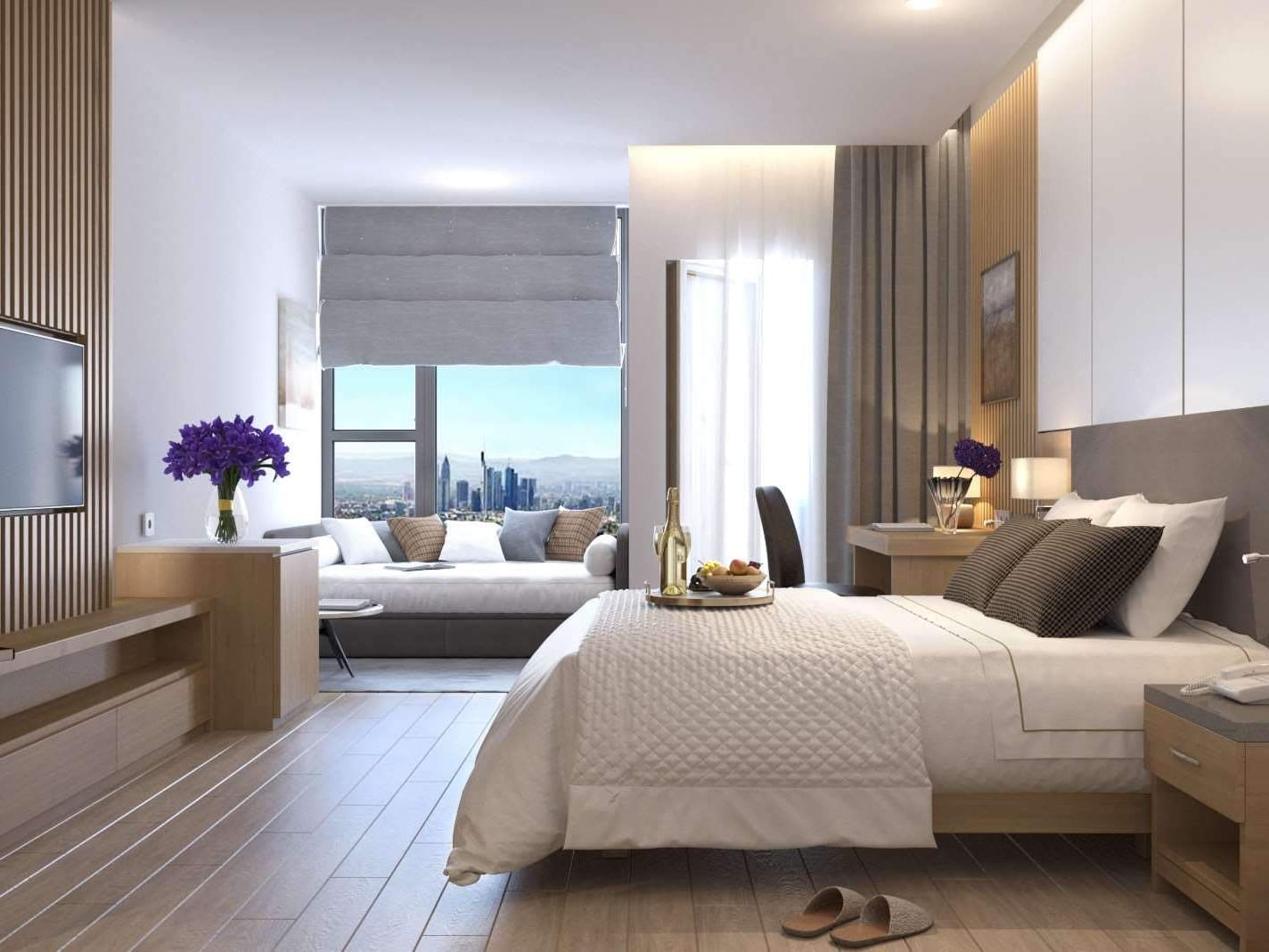 hotel room with king bed, ocean view and luxury finishings