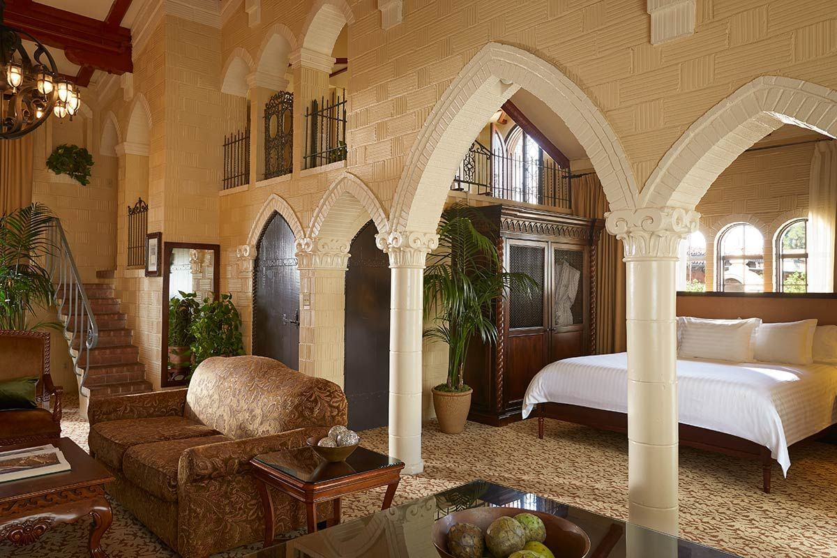 Junior suite at Mission Inn Hotel with open living room and bedr