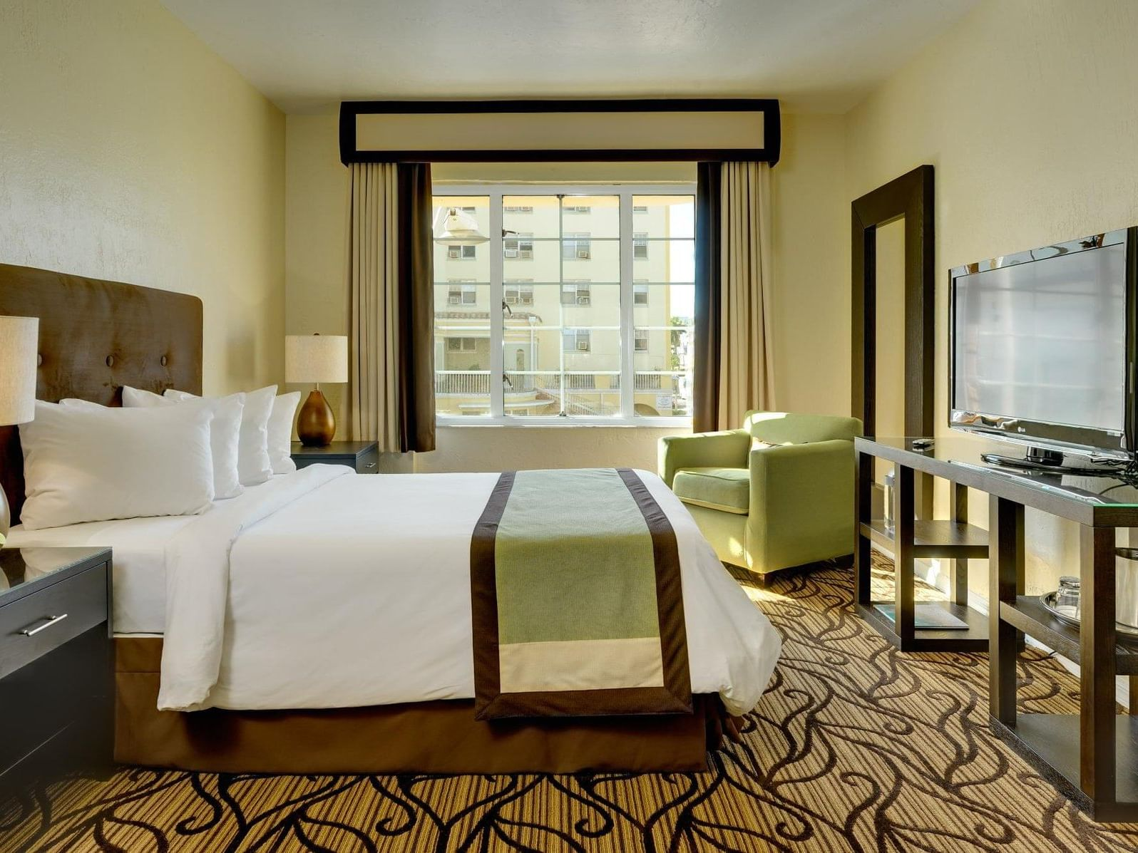 A view of Deluxe Queen room with one king bed at Essex House by Clevelander