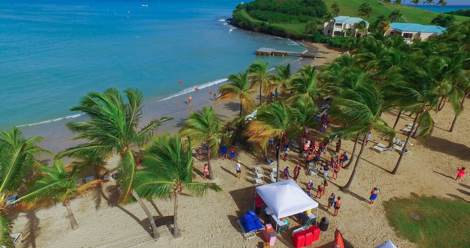 Aerial view of Mermaid Beach with crowds gathering