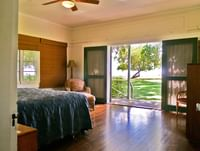 Guest room with sliding door at Waimea Plantation Cottages