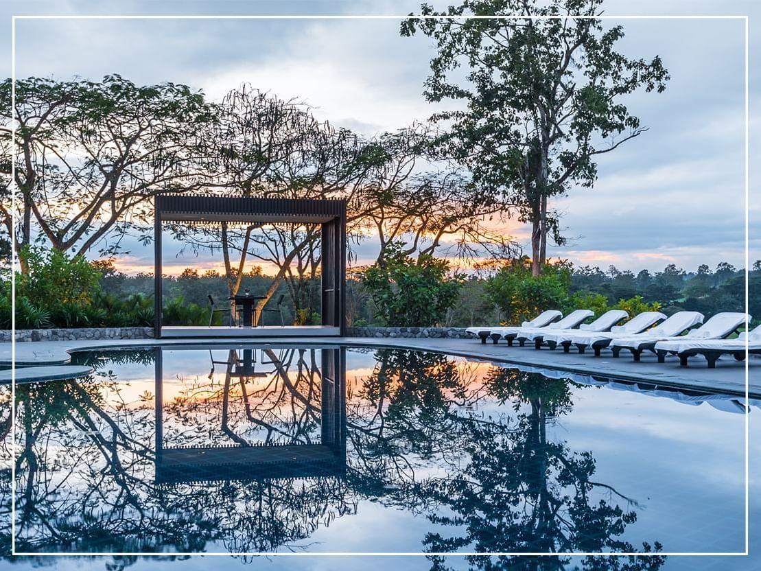 Outdoor pool with sitting area in Chatrium Golf Resort Soi Dao Chanthaburi