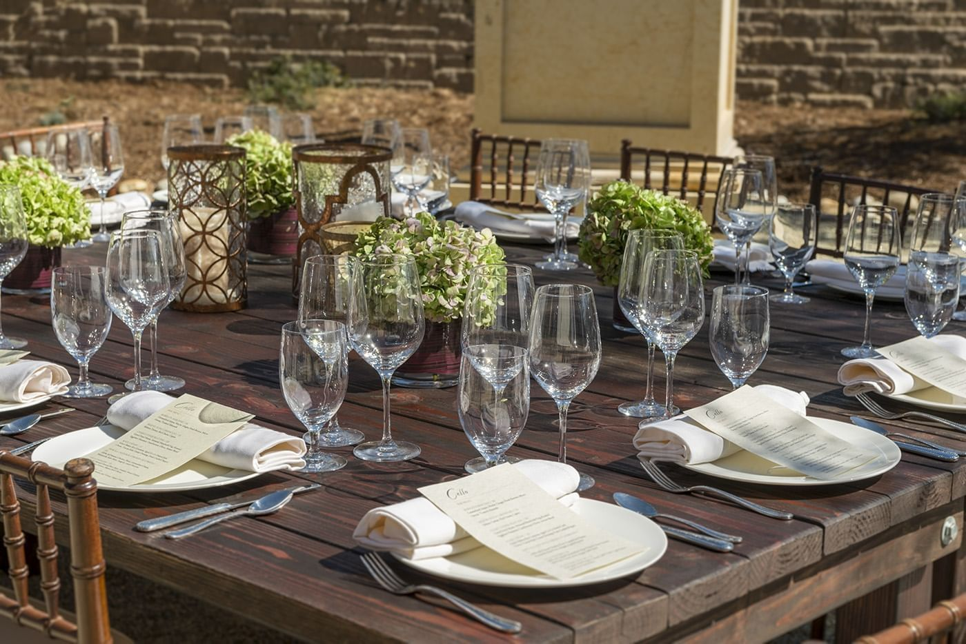 Outdoor wooden table prepared for dining