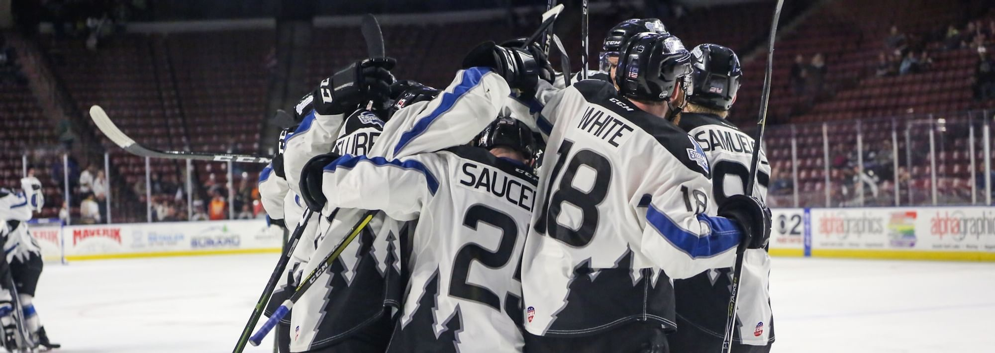 a group of hockey players in a group huddle