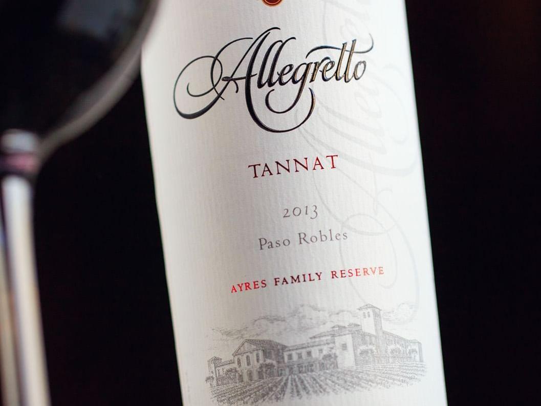 Allegretto Tannat wine bottle and wine glass