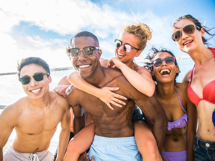 Group of friends having fun at beach at The Reef Playacar