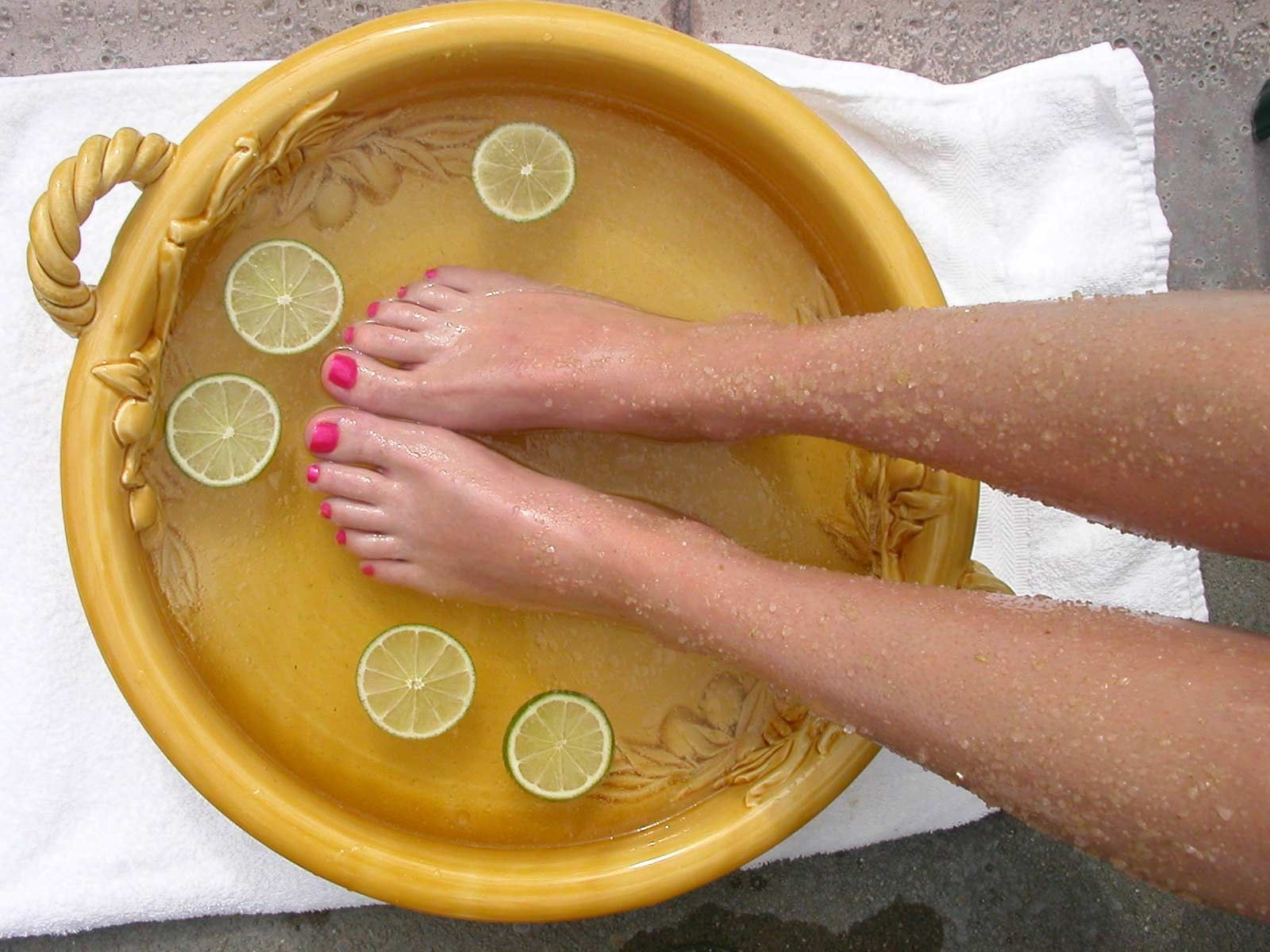A woman getting a foot treatment at Kelly's Spa & Boutique