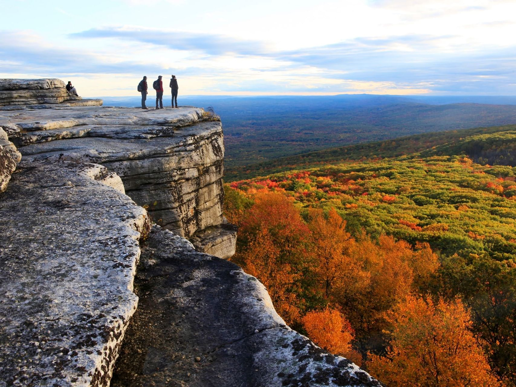 Mountain cliff overlooking fall trees