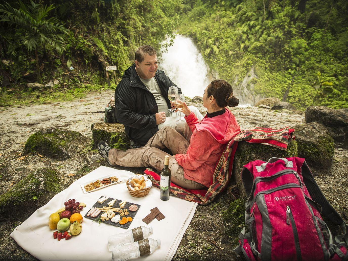 Picnic near a waterfall in Mandor Valley near Hotel Sumaq