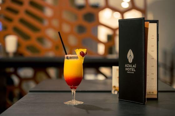 Cocktail beside the menu bar