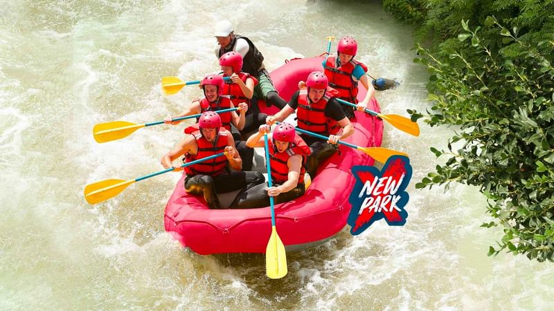 Group of friends water rafting near The Reef Resorts