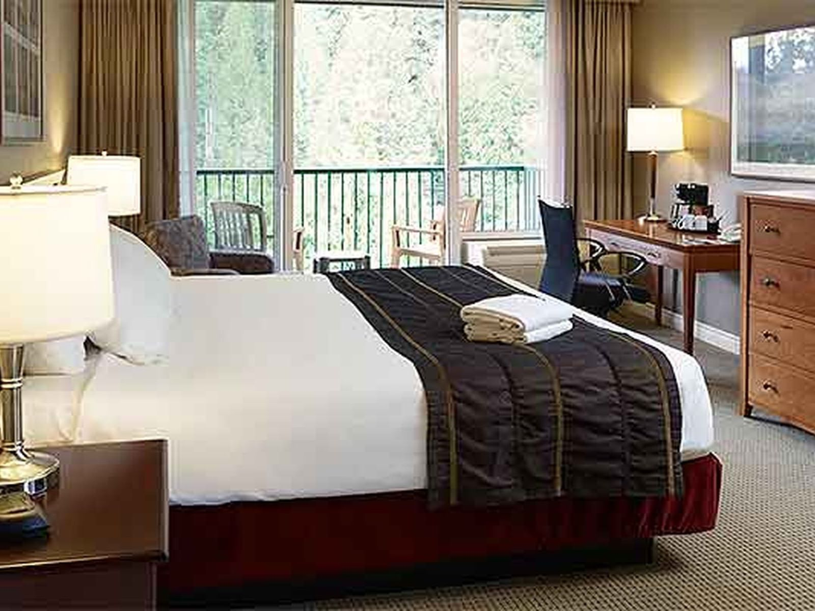 bed in hotel room with balcony