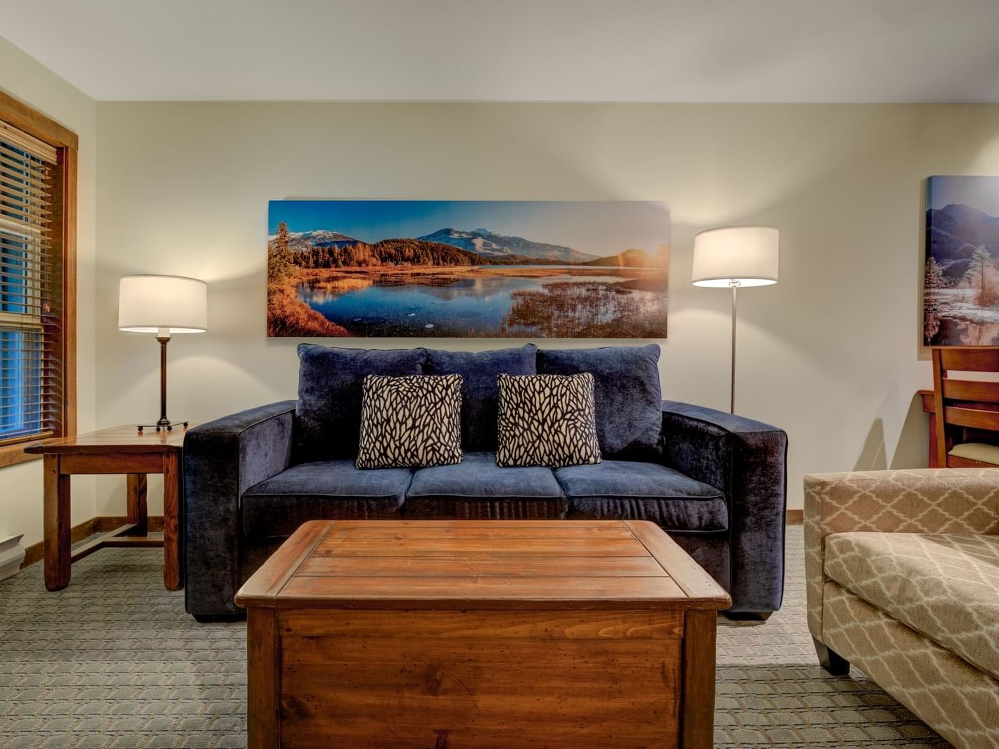 living room with blue sofa and wooden coffee table