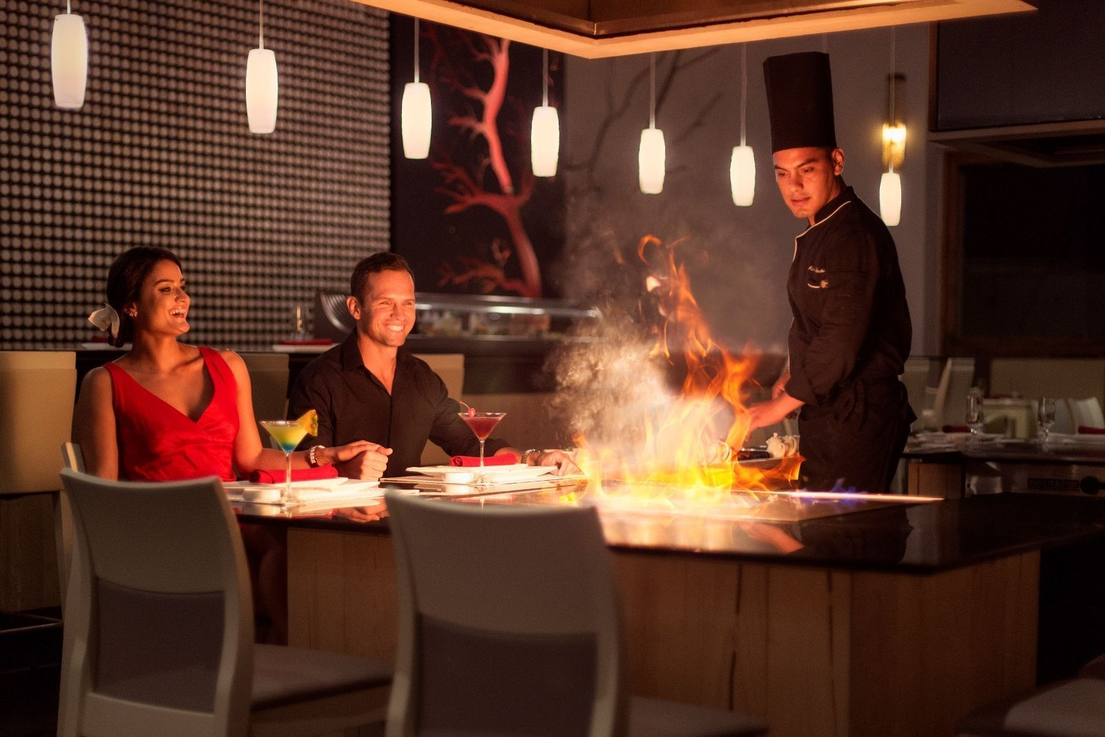 A chef cooking for a couple right at their table - Marquis Los C