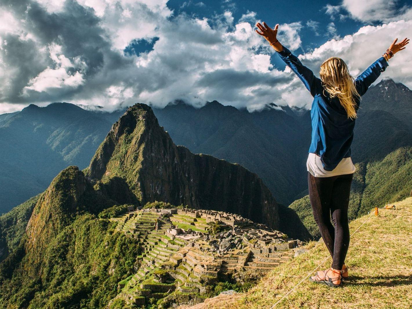 A girl on top of Machu Picchu mountain near Hotel Sumaq